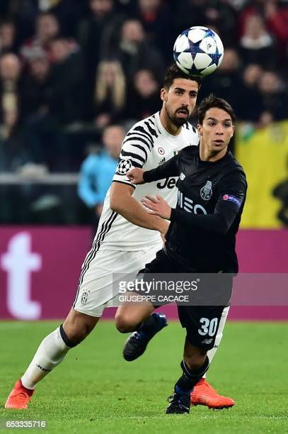 Porto's Spanish midfielder Oliver Torres vies with Juventus' midfielder from Germany Sami Khedira during the UEFA Champions League football match...