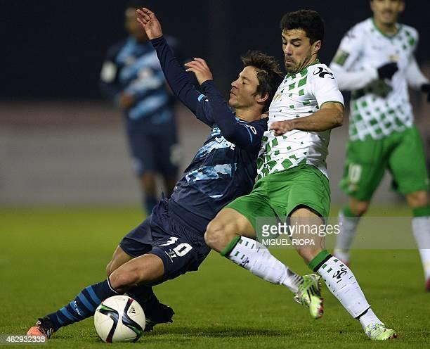 Porto's Spanish midfielder Oliver Torres vies with Moreirense's forward Pedro Coronas during the Portuguese league football match Moreirense FC vs FC...
