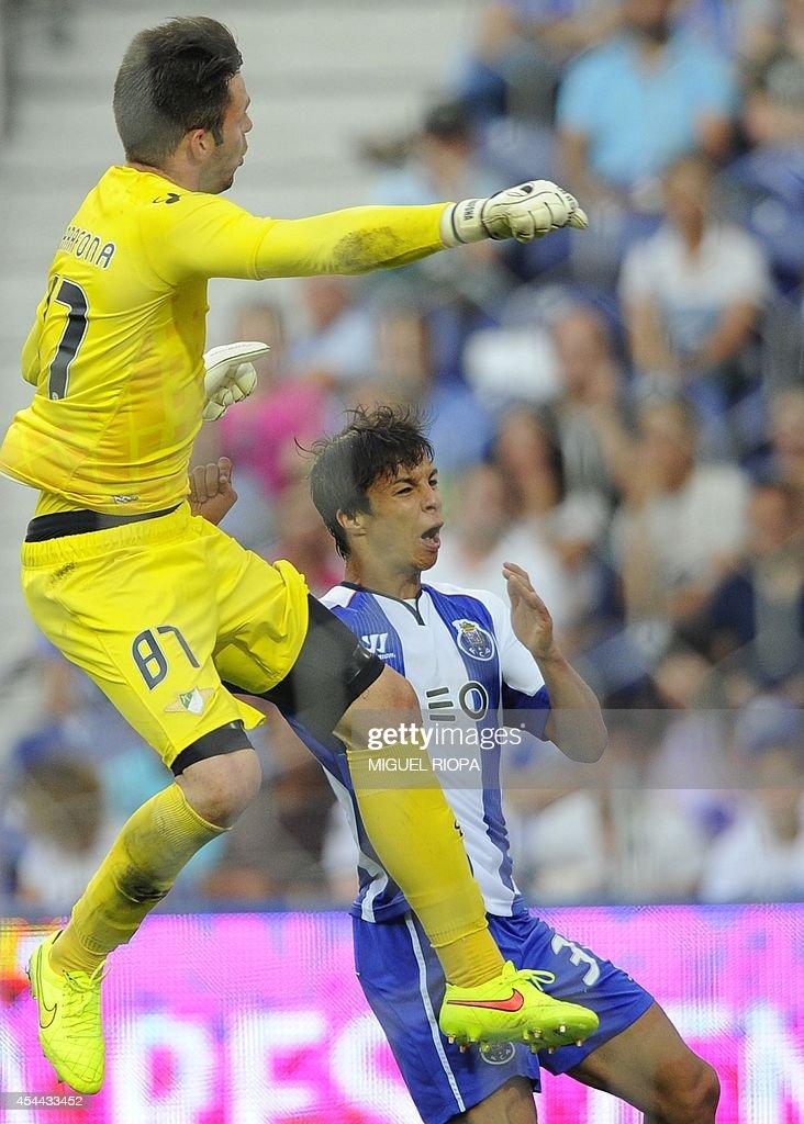 Porto's Spanish midfielder Oliver Torres (R) vies with Moreirense's goalkeeper Jose Marafona during the Portuguese league football match FC Porto vs Moreirense at the Dragao Stadium in Porto, on August 31, 2014. Porto won the match 3-0.