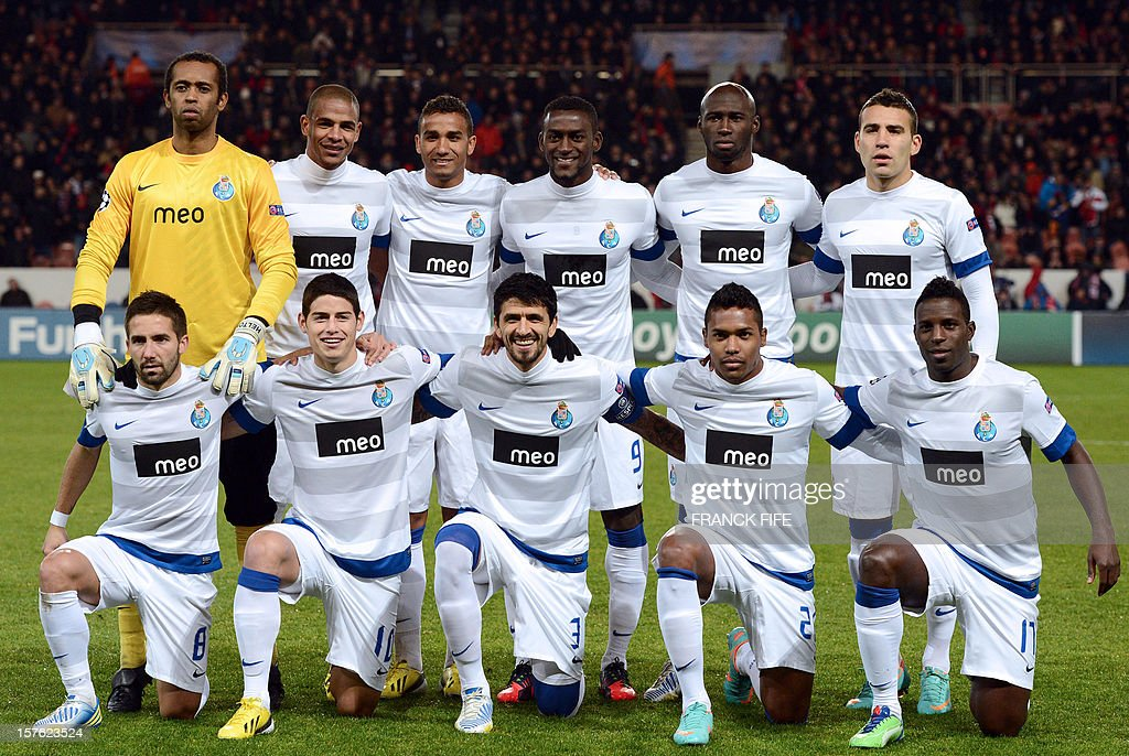 Porto's team players, (From L - Up) goalkeeper Helton, defender Danilo, midfielder Fernando, forward Jackson Martinez, defender Nicolas Otamendi and midfielder Andre Castro, (Down) midfielder Joao Moutinho, forward James Rodriguez, midfielder Lucho Gonzalez, defender Eliaquim Mangala, and forward Silvestre Varela pose before the UEFA Champions League Group A football match Paris Saint-Germain vs Porto on December 4, 2012 at the Parc des Princes stadium in Paris. Paris won 2-1. AFP PHOTO / FRANCK FIFE