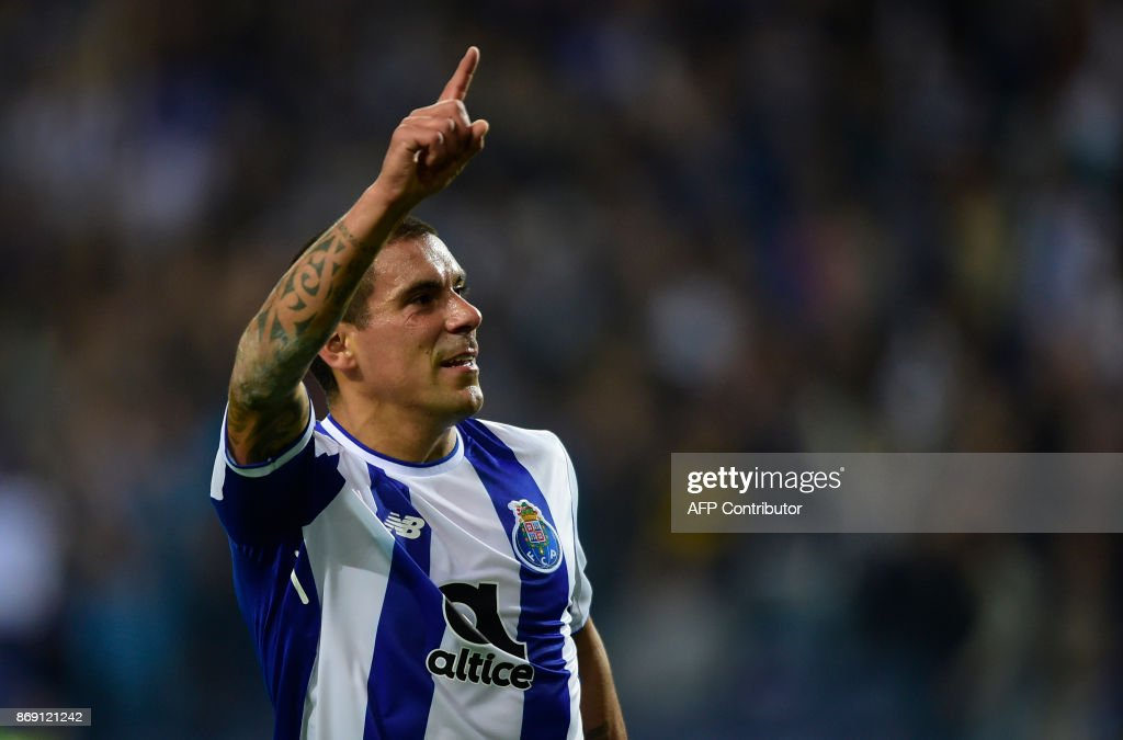 Porto's Uruguayan defender Maxi Pereira celebrates after scoring a goal during the UEFA Champions League group G football match FC Porto vs Leipzig at Dragao stadium in Porto on November 1, 2017. /