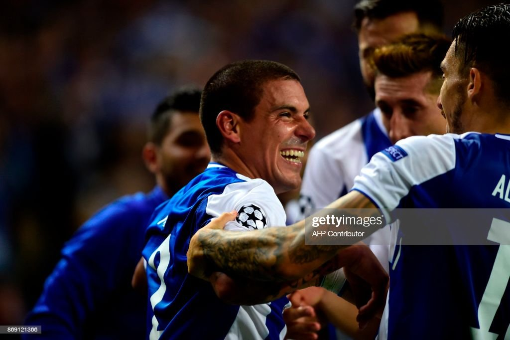 Porto's Uruguayan defender Maxi Pereira (C) celebrates with teammates after scoring a goal during the UEFA Champions League group G football match FC Porto vs Leipzig at Dragao stadium in Porto on November 1, 2017. /