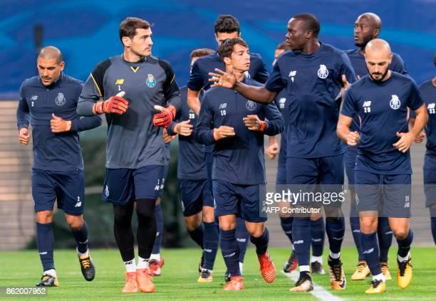 Porto's Uruguayan defender Maxi Pereira Spanish goalkeeper Iker Casillas Spanish midfielder Oliver Torres Cameroonian forward Vincent Aboubakar...