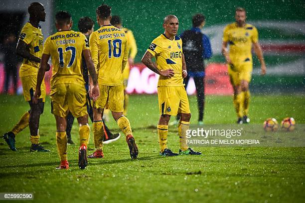 Porto's Uruguayan defender Maxi Pereira stand on the pitch at the end of the Portuguese league football match OS Belenenses vs FC Porto at the...