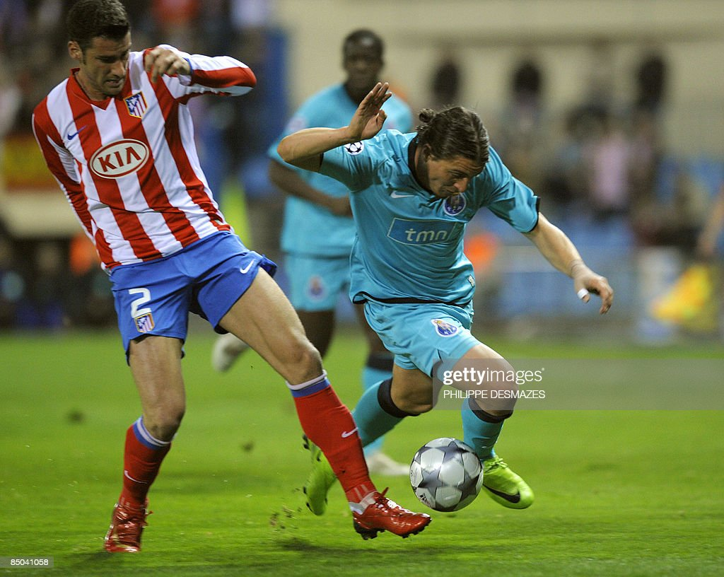 Porto's Uruguayan forward Cristian Rodriguez fights for the ball with Atletico Madrid's Greek defender Giourkas Seitaridis during their Champions...