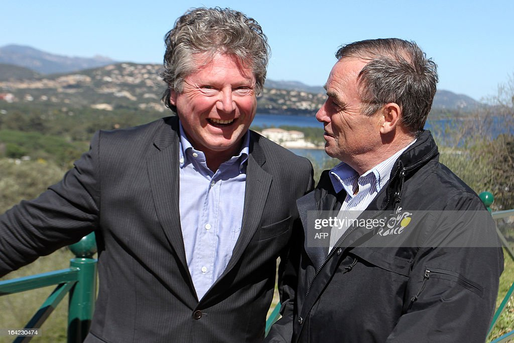 Porto-Vecchio Mayor Georges Mela (L) poses with Bernard Hinault, French former cyclist champion and member of the directory board of the Tour de France cycling race on March 21, 2013 for the hundred days before the start of the Tour de France cycling race which will start in Porto Vecchio, Corsica. AFP PHOTO / PASCAL POCHARD-CASABIANCA