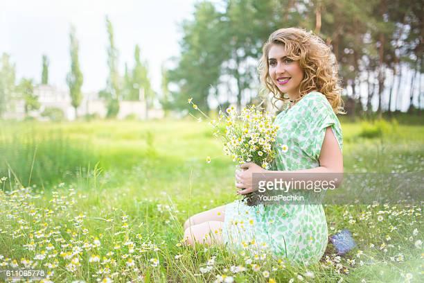 Portrait a girl with a bouquet