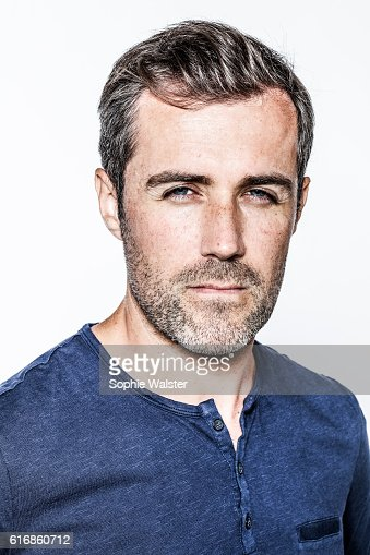 portrait, arrogant handsome bearded young man with staring blue eyes : Stock Photo
