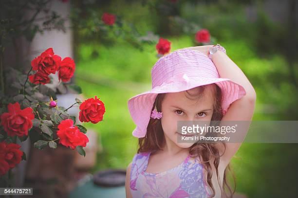 Portrait beautiful girl outdoor in a roses garden