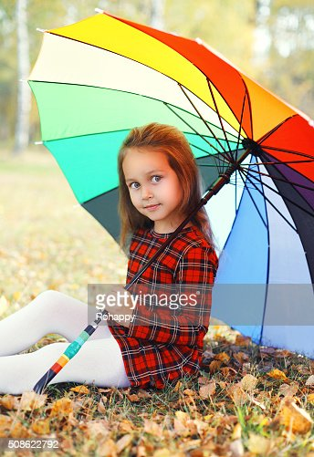 Portrait beautiful little girl child with colorful umbrella in autumn : Stock Photo