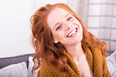 Portrait beautiful red-haired woman in orange cardigan