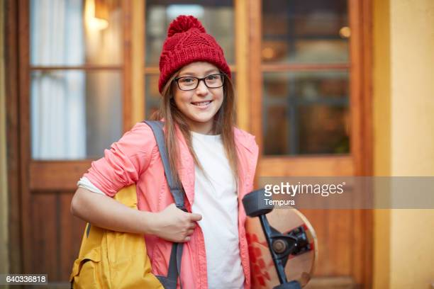 Portrait before going to school with skateboard.