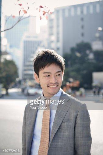 Portrait businessman in city