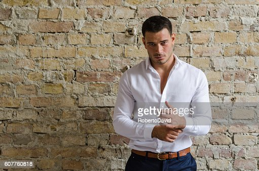 Portrait businessman posing in front of the old wall : Stock Photo