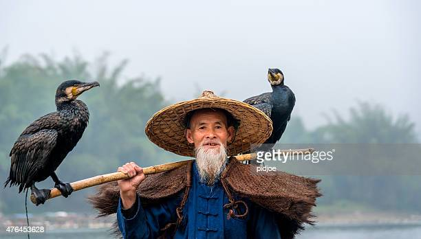 Portrait Chinese traditional fisherman with cormorants fishing, Li River China