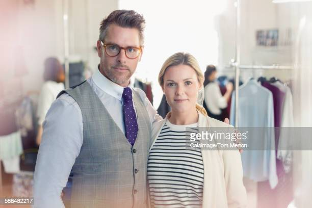 Portrait confident fashion designers in office