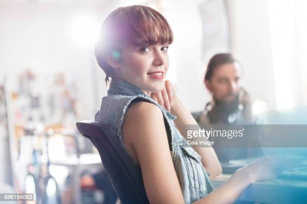 Portrait confident female design professional in office