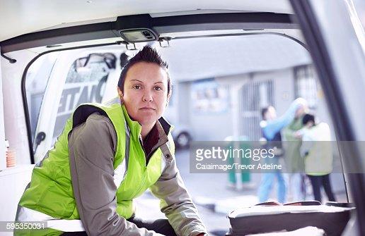 Portrait confident rescue worker in ambulance