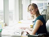 Portrait female architect at desk