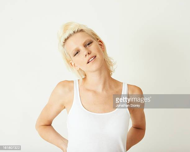 Portrait for blond female with hands on hips