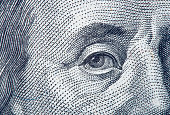 Portrait fragment of Benjamin Franklin close-up from one hundred dollars bill