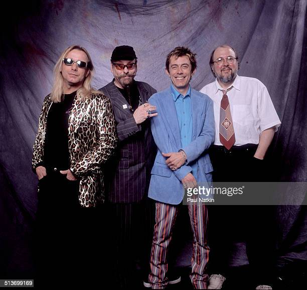 Portrait from left Tom Petersson Rick Nielsen Robin Zander and Bun E Carlos of the band Cheap Trick as they pose backstage at the Metro auditorium...