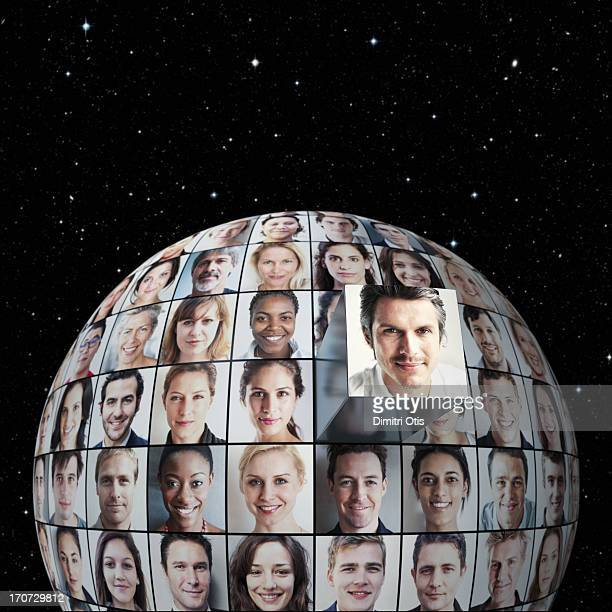 Portrait grid on globe, one standing out