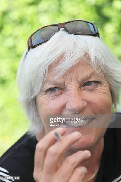 Portrait Happy Senior Woman smoking 2