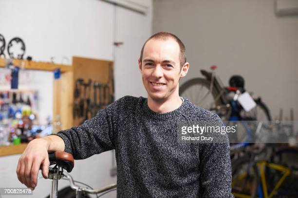 Portrait if bicycle mechanic in workshop