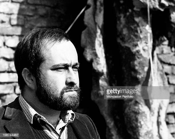 Portrait in profile of the Italian singer Lucio Dalla in an inner courtyard of the Sforzesco Castle of Milan Milan March 1968