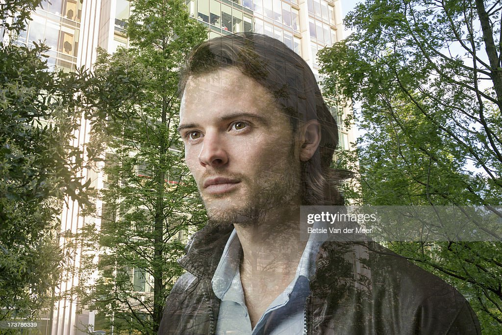 portrait man, city and trees reflected in window. : Stock Photo