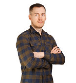 Portrait man in a checkered shirt, arms crossed on chest. Isolated on white background