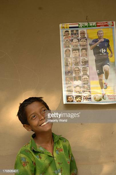 Portrait of 12 years old Saiful in his room He dreams of being a football celebrity like Ronaldinoh of Brazil or Zidane of France He keeps a portrait...