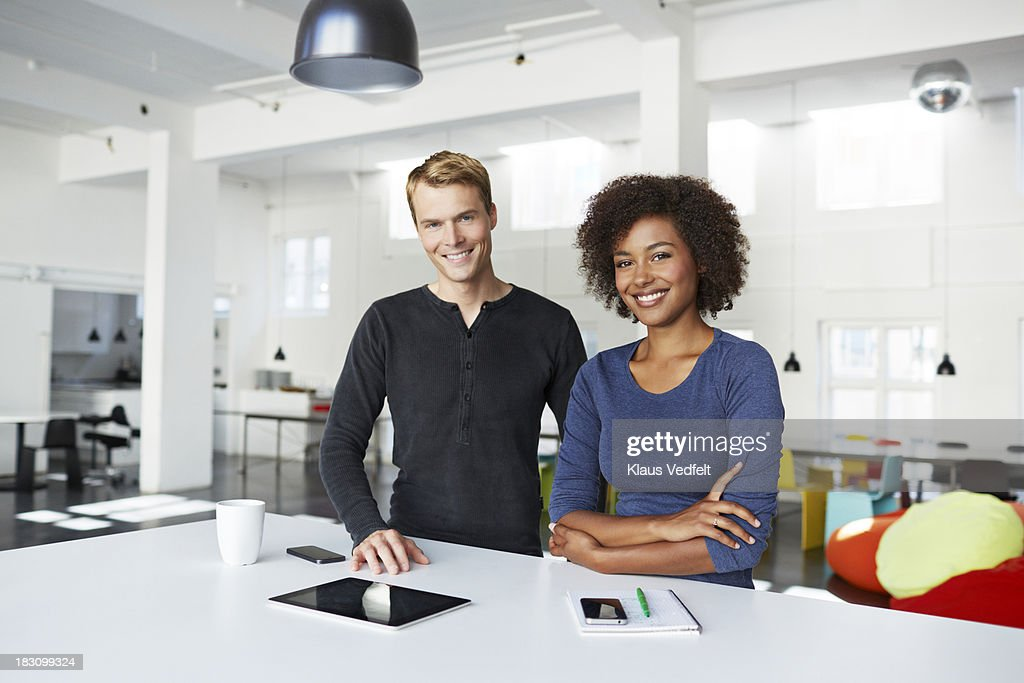 Portrait of 2 creatives at agency : Stock Photo