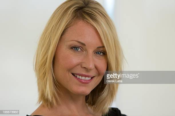 CU Portrait of 40-something Blonde Woman
