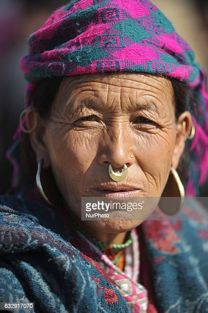 A portrait of 60 yrs old PARA TAMANGE from Humla come to participate in a parade during celebration of Sonam Losar festival or Lunar New Year which...