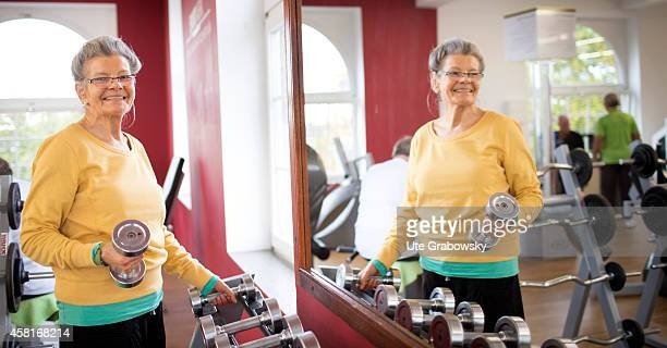 Portrait of a 75yearold woman in a gym on October 09 in Bonn Germany The WHO recommends older adults to stay physically active in order to increase...