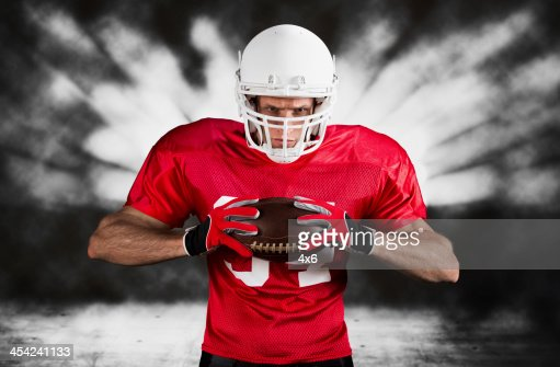 Portrait of a American football player : Stock Photo