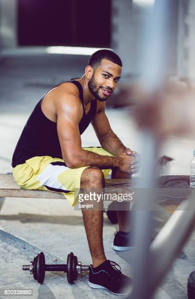 Portrait of a Athlete Sitting in a Gym