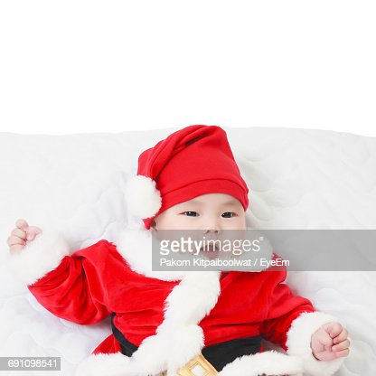 Portrait Of A Baby Dressed As Santa Claus