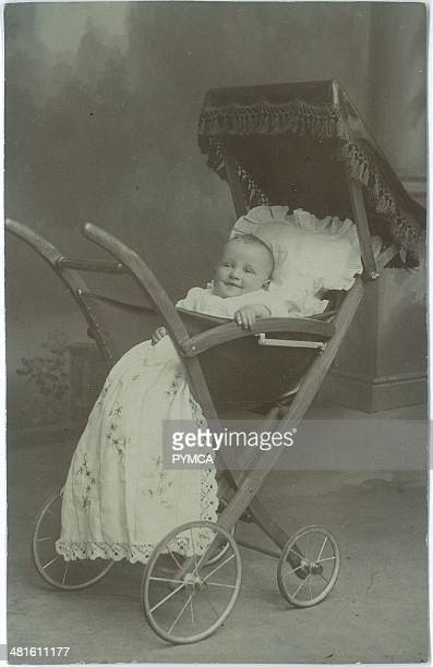 Portrait of a baby in a carriage circa 1900s