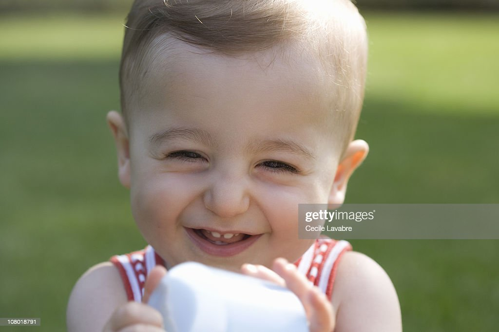 Portrait of a baby laughing : Stock Photo