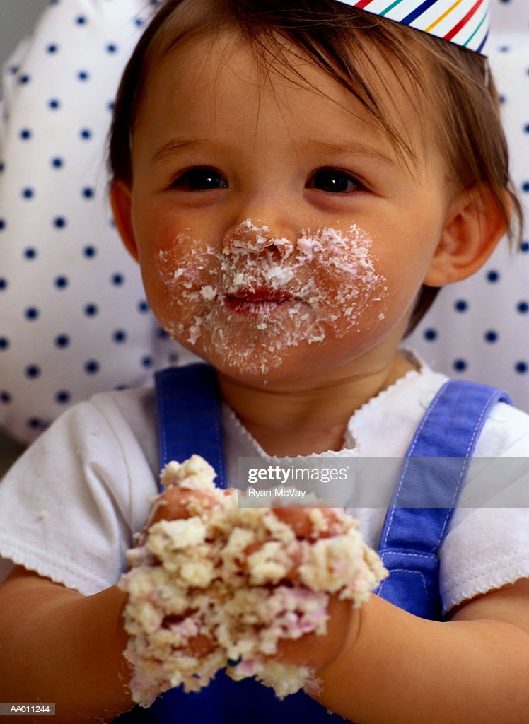 Portrait of a Baby With Birthday Cake on Her Face