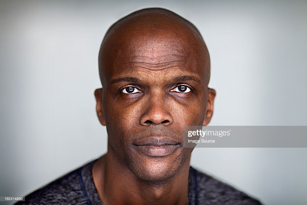 Portrait of a bald man looking at camera