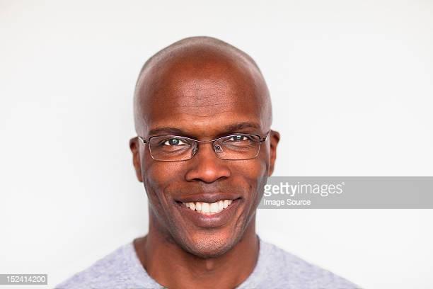 Portrait of a bald man smiling