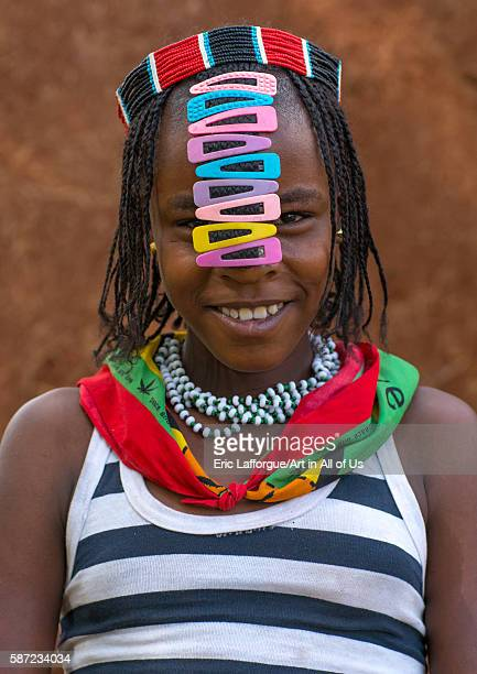 Portrait of a bana tribe teenage girl with clips in the hair omo valley key afer Ethiopia on March 17 2016 in Key Afer Ethiopia