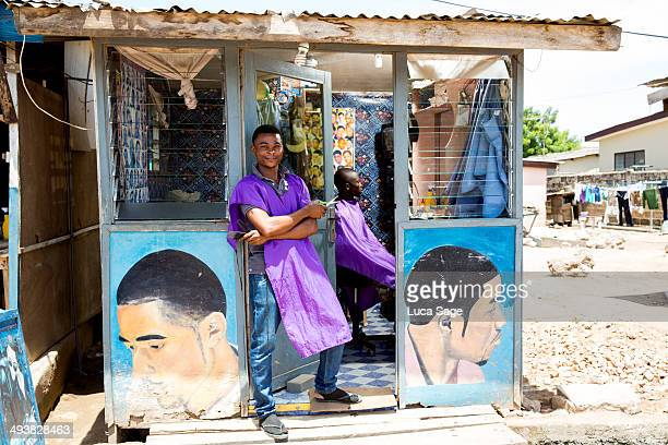 Portrait of a Barber in front of his shop, Africa
