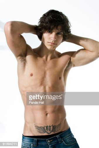 Portrait of a bare chested young man : Stock Photo