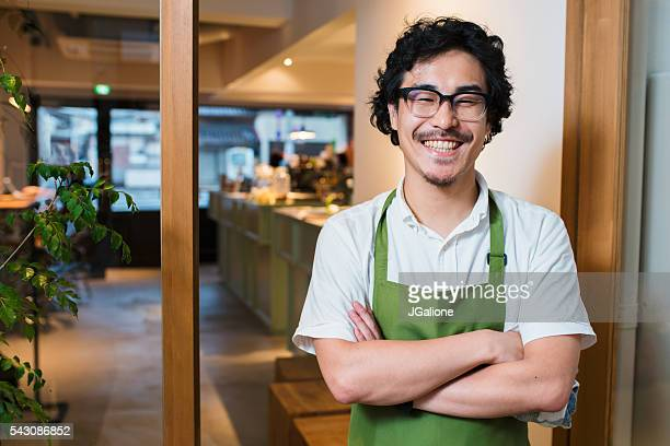 Portrait of a barista in an apron
