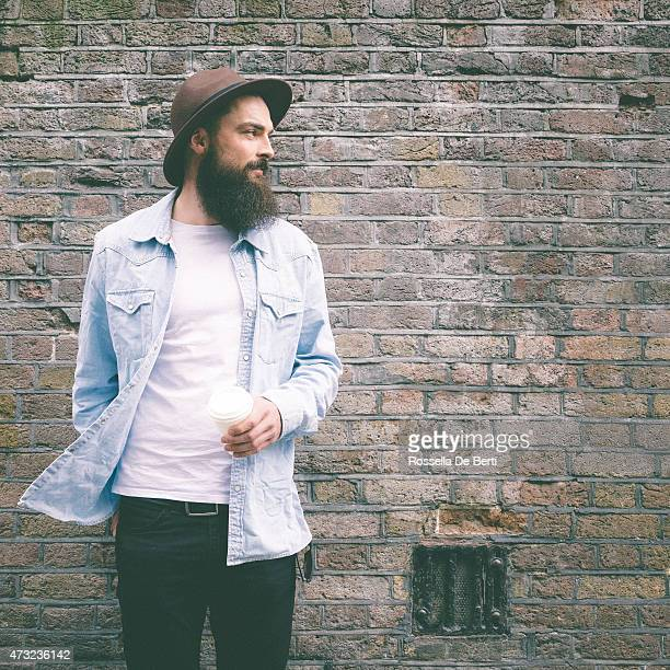 Portrait Of A Bearded Man On Brick Wall Background